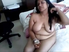 Indian aunty drinking beer after fuck session
